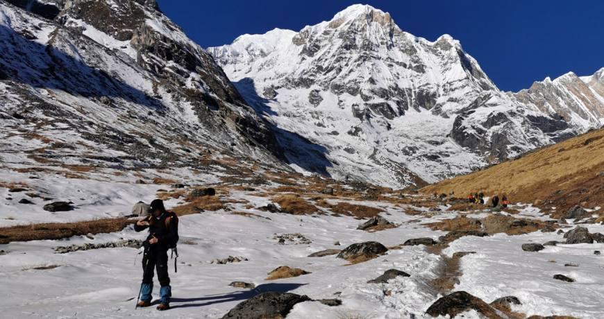 A solo female trekker heading towards the Annapurna Base Camp (4130 meters)