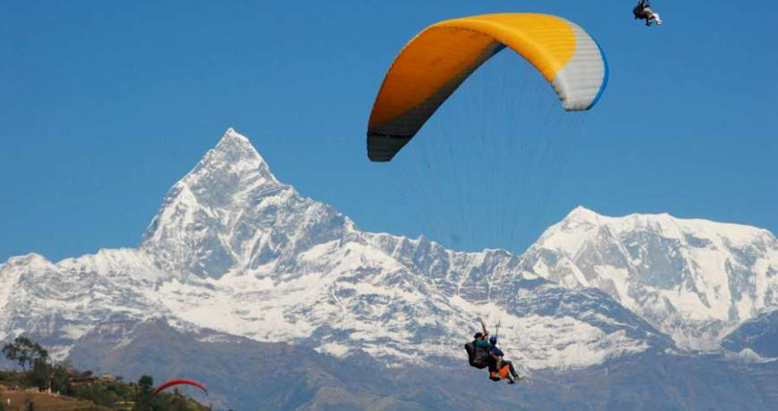 Paragliding in Pokhara Sarangkot and Mt. Fishtail on the backgrounds