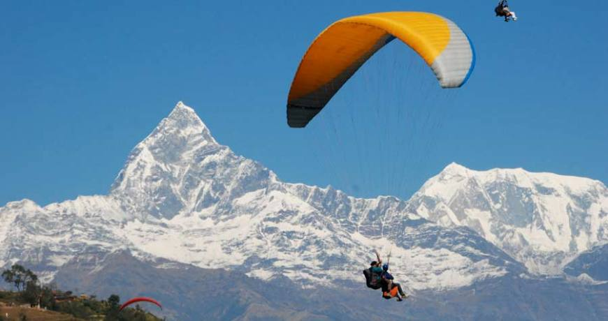 Paragliding in Pokhara with the Fishtail peak on background